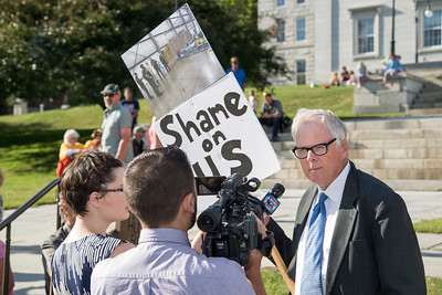 Keith Kennedy of Burlington voices his disapproval to the media as hundreds gather at the Vermont State House in Montpelier on Monday to protest U.S. Immigration policy.  Josh Kuckens/Staff Photo