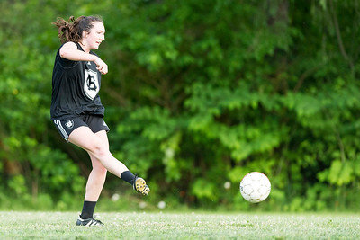Emily George sends a ball towards the goal during pickup soccer at Montpelier High School on Tuesday.  Josh Kuckens/Staff Photo