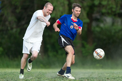 Emrys Bagiackas and Dustin Rand enjoy friendly competition during pickup soccer at Montpelier High School on Tuesday.  Josh Kuckens/Staff Photo
