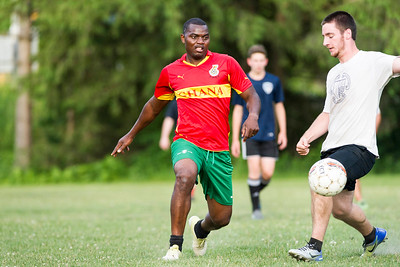 Emmanuel Riby-Williams (left) and Ned Mulligan battle for the ball during pickup soccer at Montpelier High School on Tuesday.  Josh Kuckens/Staff Photo