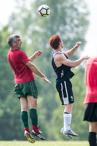 Waterbury's Loren Thompson (L) and Craftsbury's Alex Veteri (R) share some hang time during Men's League soccer action on Sunday.  Josh Kuckens/Staff Photo