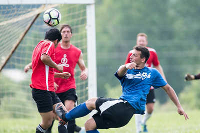 Craftsbury's Austin Masi attempts a bicycle kick over Waterbury defenders during Men's League soccer action on Sunday.  Josh Kuckens/Staff Photo