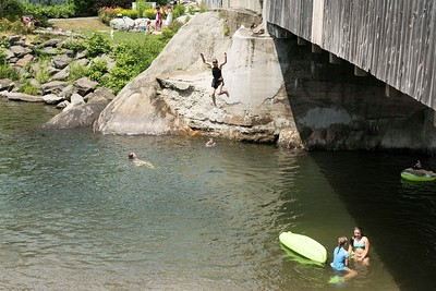 Vermonters seeking relief from the heat wave flock to the Mad River at Big eddy Covered Bridge in Waitsfield on Sunday.  Josh Kuckens/Staff Photo