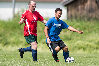 Waterbury's Sam Bueti (L) battles Craftsbury's Austin Masi during Men's League soccer action on Sunday.  Josh Kuckens/Staff Photo