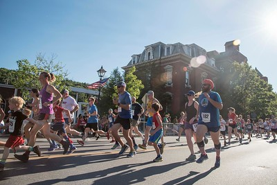 Runners set out on State Street for the Montpelier Mile before the Independence Day Parade on Tuesday.  Josh Kuckens/Staff Photo
