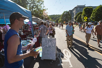 Tim Weller of Bristol showers State Street with bubbles before the Independence Day Parade in Montpelier on Tuesday.  Josh Kuckens/Staff Photo