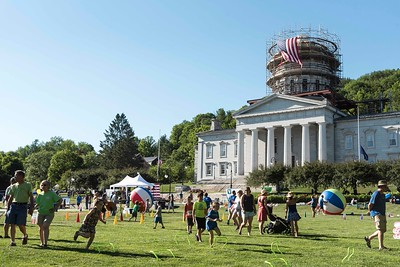 The State House Lawn is full of activity before the Independence Day Parade in Montpelier on Tuesday.  Josh Kuckens/Staff Photo