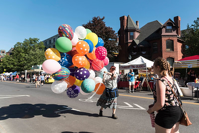 Lisa Mattogno of Rubber Bubbles walks down State Street, balloons in tow, before the Montpelier Independence Day Parade on Tuesday.  Josh Kuckens/Staff Photo