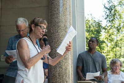 "Linda Prescott of Middlesex joins others in reading Frederick Douglass's speech ""The Meaning of the 4th of July to the Negro"" on the steps of the Kellogg-Hubbard Library in Montpelier on Tuesday.  Josh Kuckens/Staff Photo"