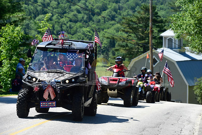 Jeb Wallace-Brodeur / Staff Photo A group of off-road vehicles parade down Route 12 Wednesday at the Worcester Independence Day parade celebration.