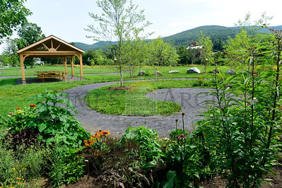 Jeb Wallace-Brodeur / Staff Photo The new Water Street Park in Northfield features a picnic shelter, trails, whimsical birdhouses and flower gardens.