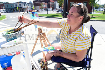 Alison Bergman, of St. Johnsbury, an art teacher in the Cabot school system, works on a painting Thursday in Barre while taking a three-day outdoor painting class at Studio Place Arts.