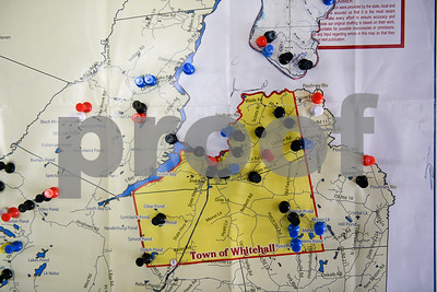 Seen here is a map Brian Gosselin has compiled of reported sightings. Each pin represents a different color: black is sightings/visual encounters, blue is vocalizations, red are tracks, white is strong smells or odors. (Robert Layman / Staff Photo)