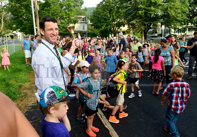 Ryan Heraty, the new principal at Union Elementary School in Montpelier, rings a bell Wednesday morning to mark the first day of the new school year. (Jeb Wallace-Brodeur / Staff Photo)