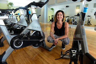 Jeb Wallace-Brodeur / Staff Photo Sky Barsch, owner of Alpenglow Fitness, poses Friday in her new indoor cycling studio on Main St., in Montpelier.