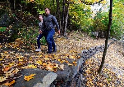 New England Culinary School students Ian Plunk and Brooke Perry walk Thursday along the leaf-strewn Tower Trail to Hubbard Park in Montpelier.