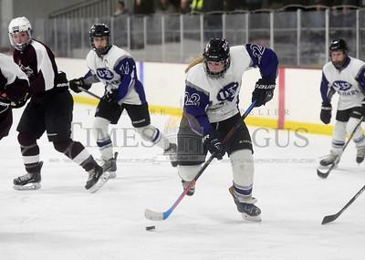 U-32 freshman Allie Guthrie carries the puck up the ice during the first period of the Raiders' game against the Kingdom Blades on Wednesday.