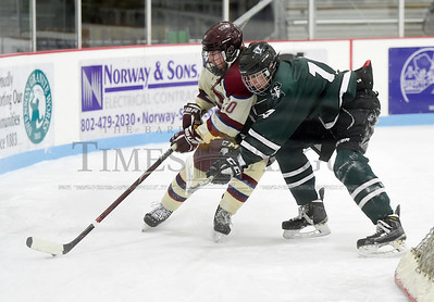 Spaulding senior Jesse King battles behind the net with Stowe senior Samuel Schoepke during the first period of their game Wednesday.