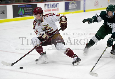 Norwich University freshman Brett Ouderkirk handles the puck as Babson College sophomore Patrick Flynn defends during the first period of their game Friday.