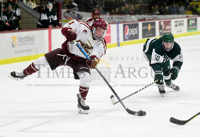 Norwich University sophomore Ryan Boucher unleashes a shot on goal as Babson College freshman John Corrigan defends during the first period of their game Friday.