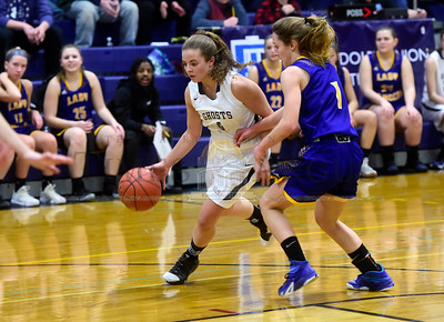 Randolph senior Rielle Brassard dribbles past the defesnse of Lamoille senior Isabelle Sullivan during the first half of their game Thursday.