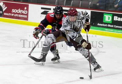 Norwich University sophomore Carter Cowlthorp gets around the defense of New England College junior Patrick DeBlois during the first period of their game Friday.