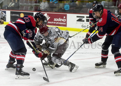 Norwich university sophomore Ryan Boucher battles for the puck with New England College sophomore Nicholas Rein during the first period of their game Friday.