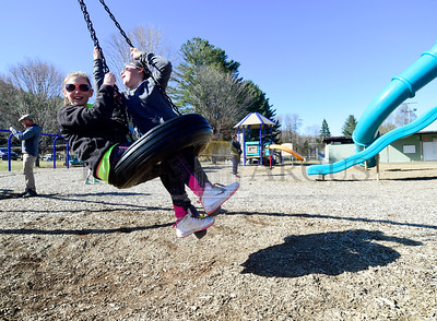 Friends Aubrey Verdon, left, and Lillian Pierce, both 10 of Williamstown, enjoy warm weather and sunshine at Palyground 2000 in Barre Wednesday during their spring break from school.