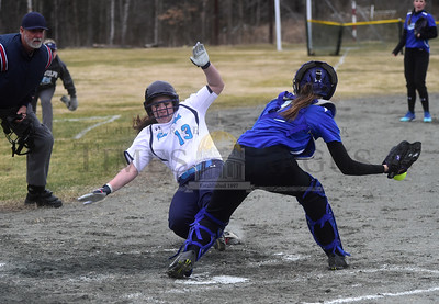 Randolph's Tricia Eaccarino slides safely into homp plate ahead of the tag attempt from Williamstown's Hailey Miller during the second inning of their game Thursday.