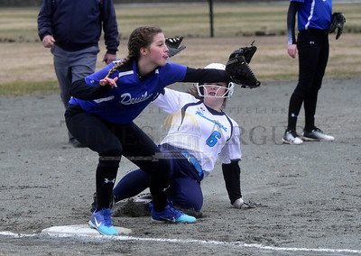 Randolph's Ella Davignon slides safely into third base Thursday as Williamstown's Brianna McLaughlin waits for the throw during the first inning of their game.