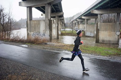The Paul Mailman 5K winner Hale Boyden of Duxbury leads the pack beneath the I-89 overpass in Montpelier on Saturday.
