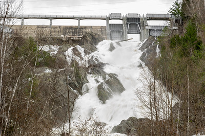 Water surges through the Waterbury Dam in Little River State Park on Sunday.