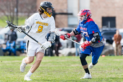 Harwood's Sayer Simmons, left, charges downfield against Hartford's Jonas Spaulding, right, during Monday's matchup in Duxbury.