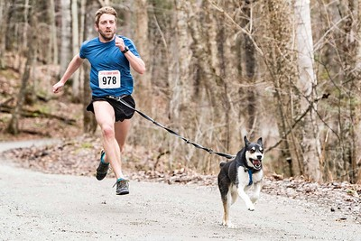 Jonnie Dunne of East Montpelier and his dog Khoda finish strong in Waterbury's Little River State Park on Sunday at the annual Mutt Strut race.