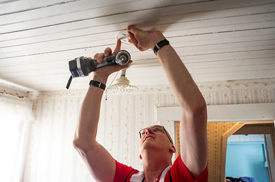 """Charles Hall, a senior disaster program manager with the Red Cross, installs a new smoke detector on the second floor of a Graniteville home Saturday during """"Sound the Alarm,"""" a national effort to prevent home fires. The event also received sponsorship from the National Life Group, Community National Bank, and Vermont Mutual Insurance Group."""