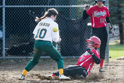 Twinfield's Dyllynn Burton, right, slides safely under the tag of People's Academy's Amy Yando, left, during Monday's matchup in Morristown.