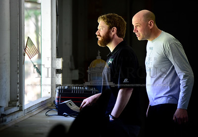 Montpelier athletic director Matt Link, left, and physical education teacher Brian Gallagher make sure the scoreboard at Montpelier's Recreation Field is working properly Wednesday as the historic field prepares to host its first high school baseball game of the year.