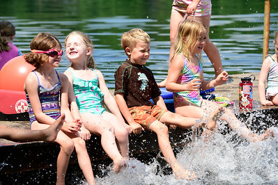 Children splash the water with their feet Wednesday during swim lessons at Curtis Pond in Calais. From left areTessa Hanna, 5, Hazel Morton-Lynch, 6, Glen Premo, 6 and Elva Teachout, 6.