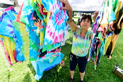 Al Morrow, of Groton, an elementary school art teacher, hangs some of her tie-dyed creations Wednesday as she preps for the Barre Farmer's Market. The market runs from 4-7 p.m., on Wednesdays in Currier Park and is followed by a weekly concert in the park.