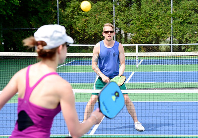 Married teachers Tyler and Ashlyn Smith, of Berlin, play pickleball Wednesday on one of six new courts at the Barre Town recreation fields. Pickleball is a fast-growing sport and Barre Town is the first in the region to have dedicated courts for the game.