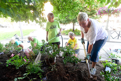 Volunteers with the Montpelier Garden Club plant choke berries and other plants Friday outside Montpelier City Hall. The plaza will be the site of weekly noon concerts starting next Thursday. From right are Lee Wilshek, Didi Brush, Linn Syz, Linda Suter and Becky Miller.