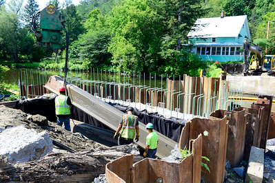 Workers from Austin Construction, of Concord, remove pilings Friday while continuing construction of the new Cummings Street bridge in Montpelier.