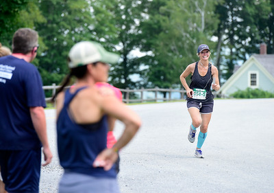 Blythe Gould, originally from Elmore, smiles as she nears the end of a relay leg in Waitsfield during the 100 On 100 Relay event Saturday. The annual realay follows Route 100 for 100  miles from Stowe to Ludlow.