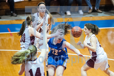 Blue Mountain Union's sophomore Lauryn Alley loses the ball while driving to the basket against Arlington on Monday night at the Barre Auditorium.  Josh Kuckens/Staff Photo