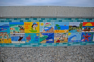October 12  The wall along the beachfront sidewalk in Capitola Village. The tiles have been purchased by individuals for $35.00 ea. as a fundraiser for Capitola. The individuals handpainted their creation of choice; to be applied as the wallfront. GREAT idea!!