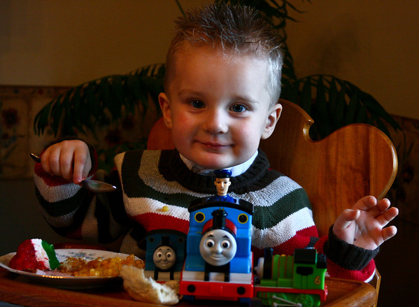 December 25, 2008 Merry Christmas This is my nephew Anderson.  He eats, sleeps, and bathes with Thomas...  He set up the trains there, not me... Here's a Link to More.