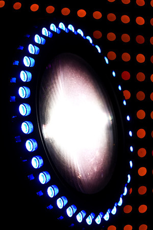November 17, 2008 (1 of 2) As Seen on TV.  This is a High End Showgun.  This is one mammoth moving light.  We have two of them here at this expo that I'm working on, and when I stand next to one, it almost comes up to my waste.  It's almost 3' tall.  If you ever watch the Today Show on NBC, you've seen these on their outdoor concert stage.  I never realized how gigantic they are.  The LED ring around the light is basically for aesthetics, but it does a great job of drawing attention to itself.  I've been told that the LED ring can even be pixel mapped.  One of these lights costs about $20,000!  The dots in the background are from the Soft LED drop.  I don't know how much it costs to buy one of these, but I do know that they cost upwords of $35,000 per week to rent!  It is an awesome piece of technology, but I can't say it's worth that much money.