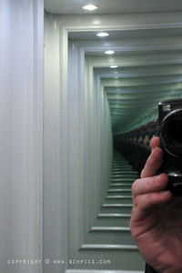 November 8, 2009  A couple of mirrors = A never ending self portrait... Inside a tiny elevator in Copenhagen....