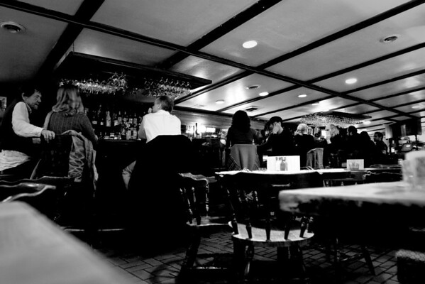 November 24, 2009 The Alchemist and Barrister.   This is a photo from over a month ago that's been sitting in Lightroom, waiting to be processed.  I finally just turned it into a BW for lack of anything better to to do with it. It's easy to tell when I get lazy....  You start seeing a lot of BW shots in the Daily Photos.