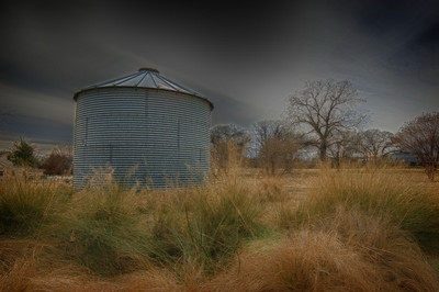 "January 30, 2011 - ""Lone Silo""  On Friday, I took some of my photog friends to my favorite farm shoot location.  Even though I have shot there several times, I can usually find a new composition.  This was the first time that I tried to isolate this small silo from the barn."